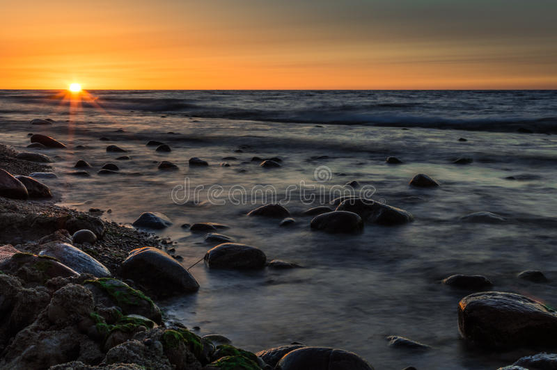 Sunset over the sea. Stone on the foreground. Sunset over the sea. Stone on the foreground royalty free stock image