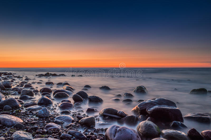 Sunset over the sea. Stone on the foreground. Sunset over the sea. Stone on the foreground royalty free stock photo