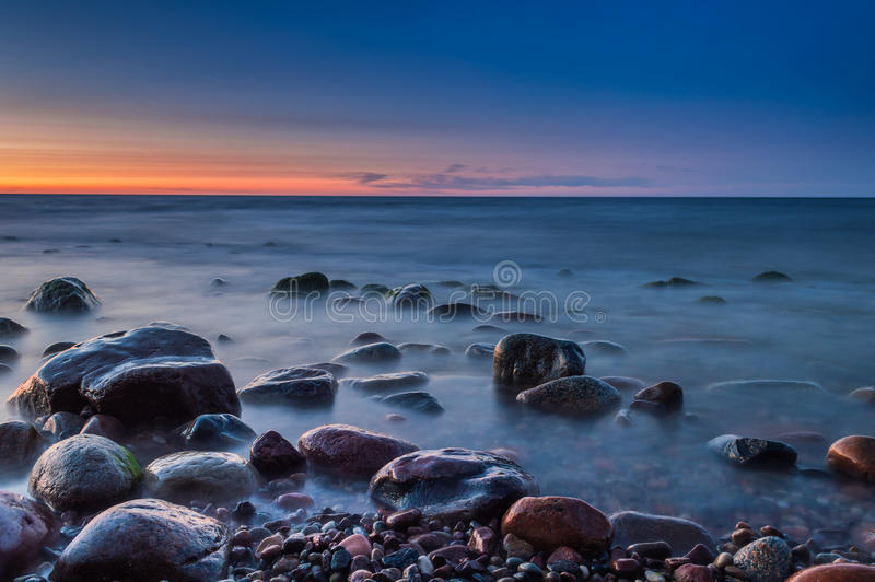 Sunset over the sea. Stone on the foreground. Sunset over the sea. Stone on the foreground stock images