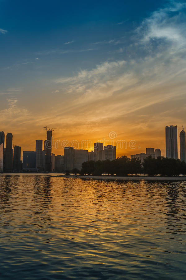 Sunset Over Sharjah Skyline Stock Photo