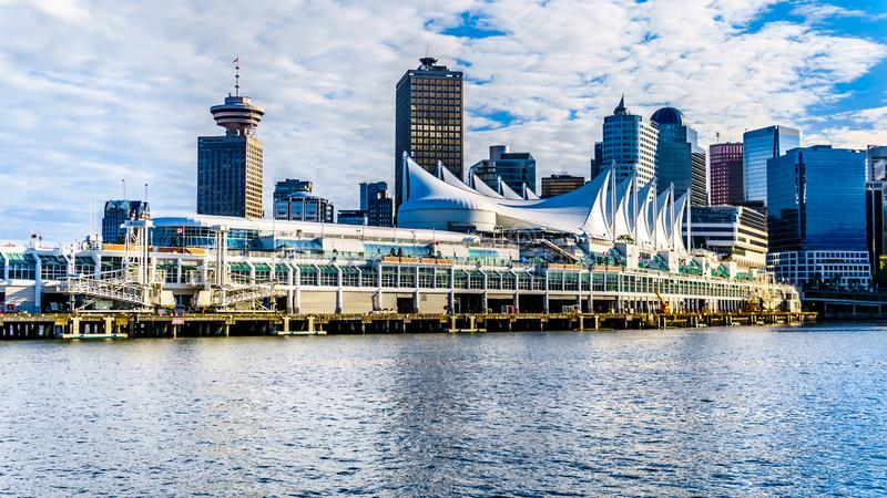 Sunset over the Skyline with High Rise Buildings and the Canada Place Cruise Terminal in Downtown Vancouver. Vancouver, British Columbia/Canada - July 11, 2019 royalty free stock photography