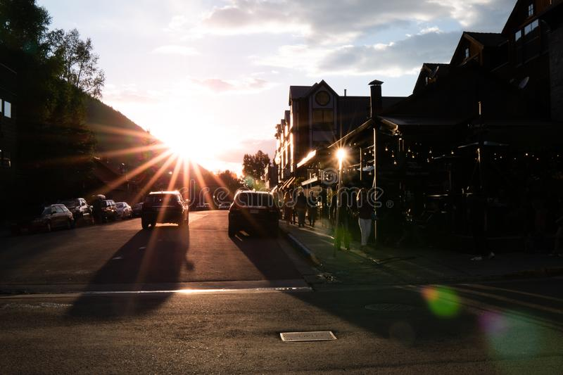 Sunset over small town street stock photo