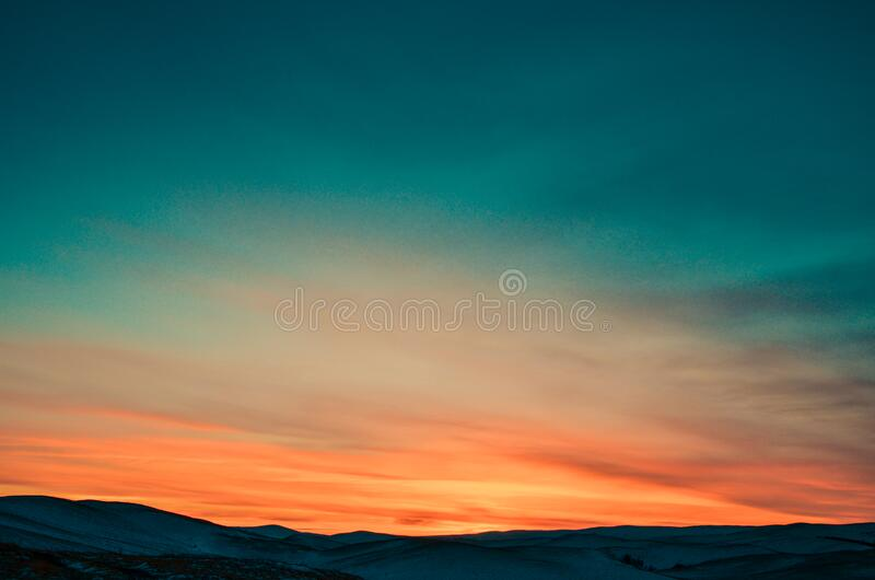 Sunset over Snow Covered Mountains royalty free stock images