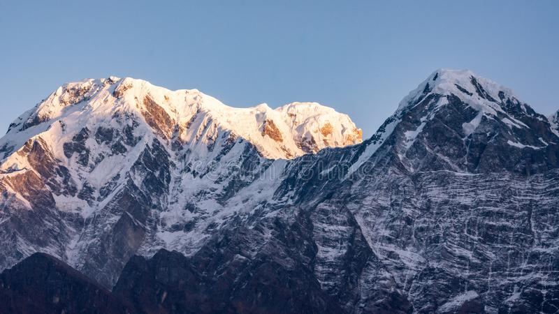 Sunset over snowcapped mountain peak Annapurna South in Nepal stock photos