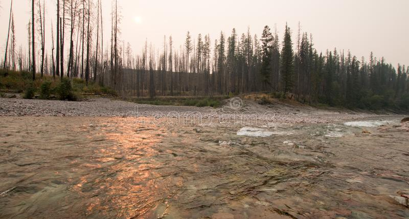 Sunset over the South Fork of the Flathead River at Meadow Creek Gorge in the Bob Marshall Wilderness complex - Montana USA. Sunset over the South Fork of the stock photography