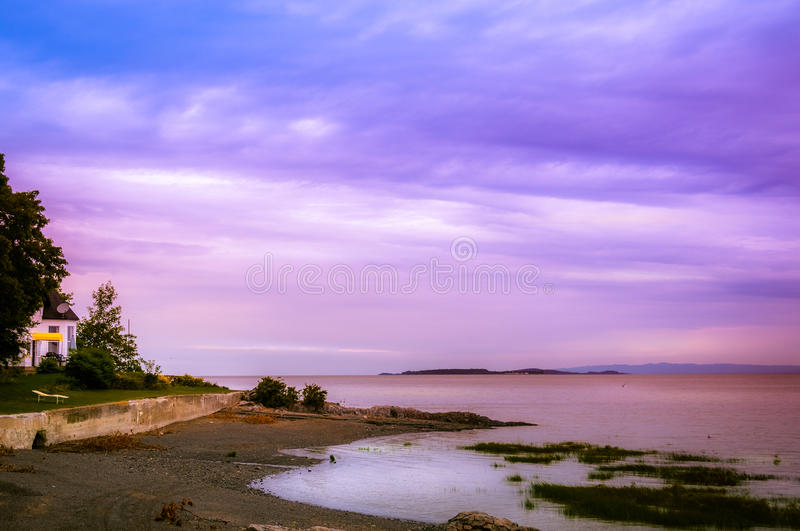 Sunset over St Lawrence river in Orleans Island,. Quebec, Canada stock image