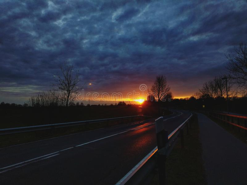 Sunset over street stock photography