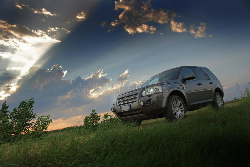 Sunset over SUV. SUV in action at the sunset royalty free stock photography