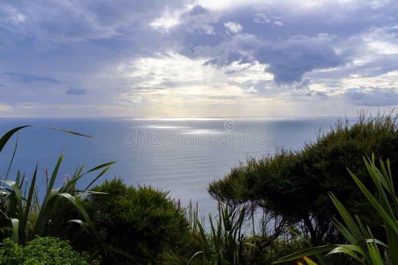 Sunset over Tasman Sea. Sun is about to set over the Tasman Sea near the coast of New Zealand royalty free stock photo