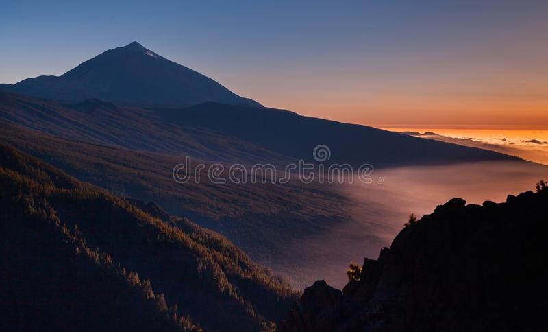 Sunset over Teide volcano in Tenerife, Canary island, Spain. Beautiful landscape. Volcano Teide and lava scenery in Teide National Park, Rocky volcanic royalty free stock photography