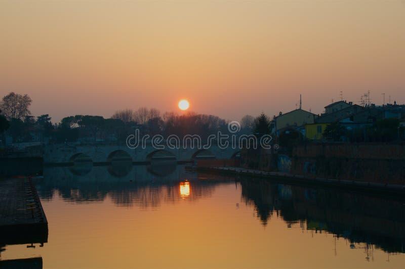 Sunset over Tiberius Bridge in Rimini stock images