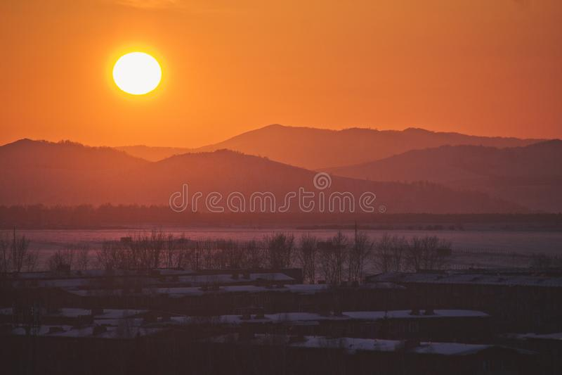 Sunset over the town. The photo was taken in Ridder East Kazakhstan. This is a small town. One of the neighborhoods is visible in the photo. Photo taken at royalty free stock photos