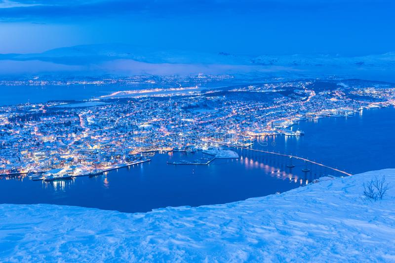 Sunset over Tromso, Norway during winter. View of Tromso Norway photographed from up the Fjellheisen cable car station in January 2019 royalty free stock photography