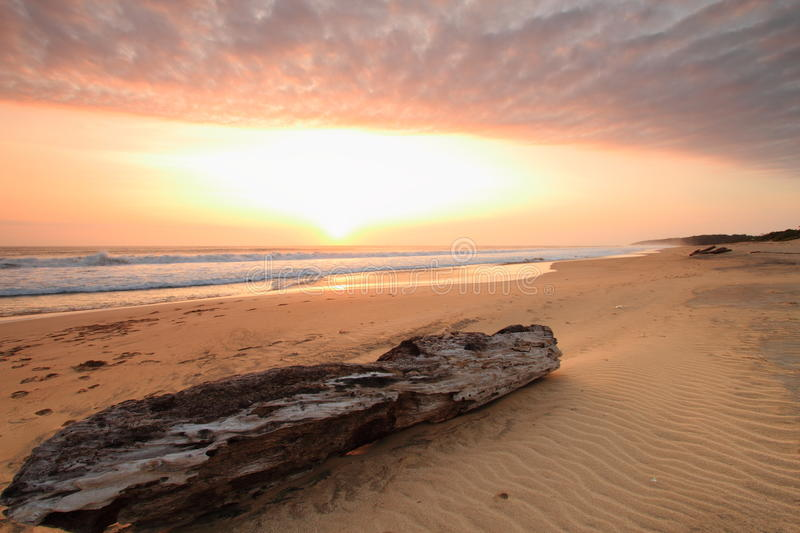 Sunset over tropical beach royalty free stock photography