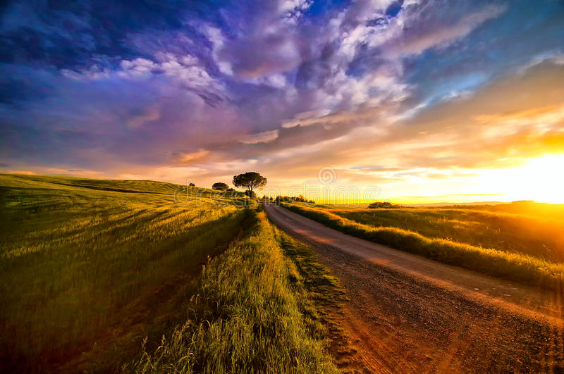 Sunset over Tuscany. Tuscany is known for its landscapes, traditions, history, artistic legacy and its influence on high culture. It is regarded as the royalty free stock photos
