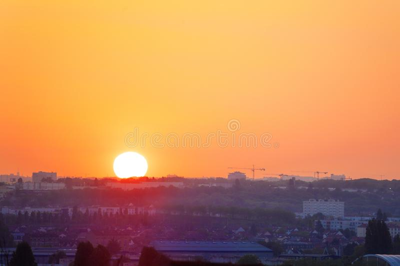 Sunset over urban area in France Paris suburbs royalty free stock photo
