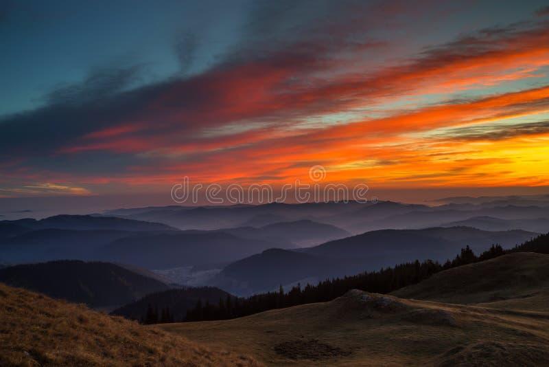 Sunset over valleys stock photo