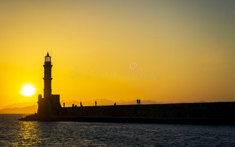 Sunset over The Venetian era harbour walls and lighthouse at the Mediterranean port of Chania. Canea, Crete, Greek Islands, Greece, Europe stock photo