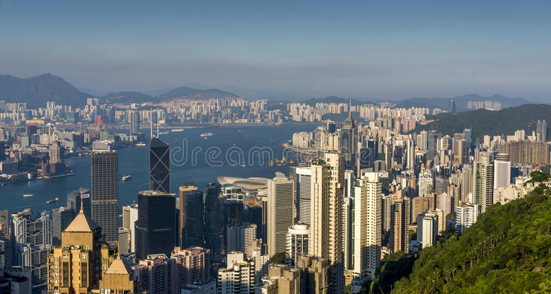 Sunset over Victoria Harbor as viewed atop Victoria Peak royalty free stock photography