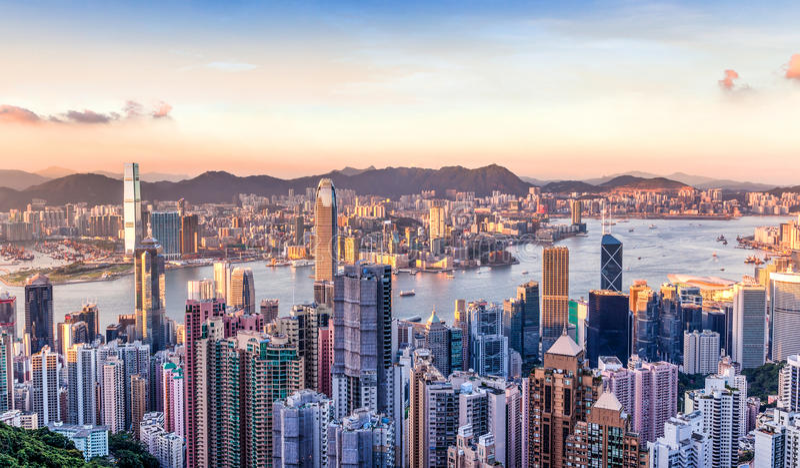 Sunset Over Victoria Harbor, Hong Kong. Sunset over Victoria Harbor as viewed atop Victoria Peak royalty free stock photos
