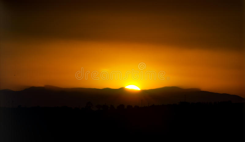 Sunset Over Village Stock Photography