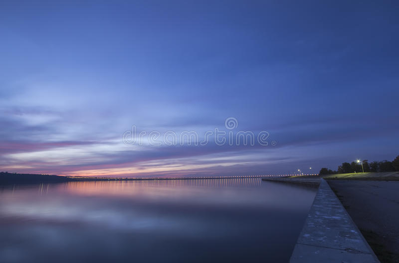Sunset over Volga River and Presidental Bridge, located in Ulyanovsk royalty free stock photos