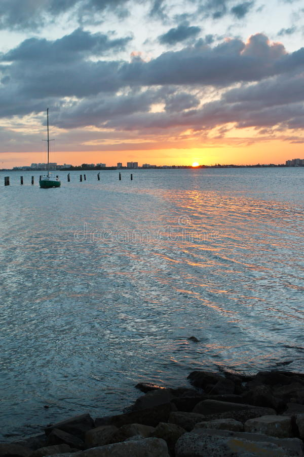 Download Sunset Over Water With Boat Stock Photo - Image: 83715937