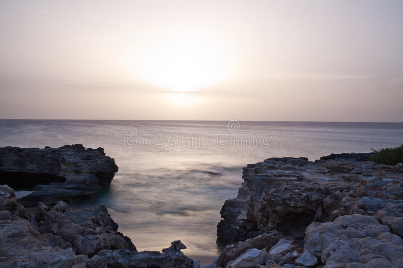 A sunset over water royalty free stock photo