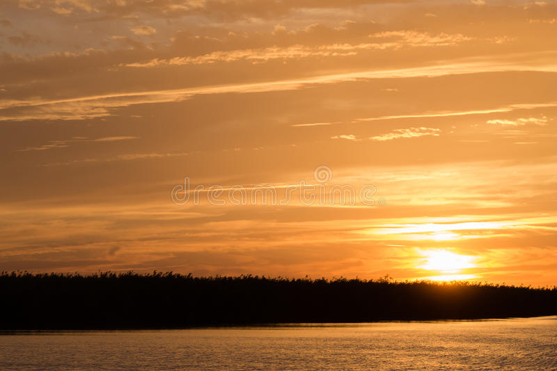Sunset over water. From Delta del Po, Italian landscape. water and sky stock photo