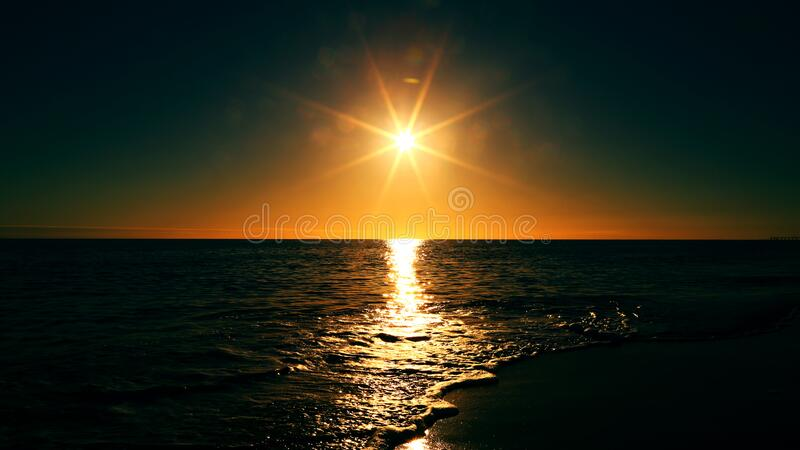 Sunset over water horizon royalty free stock photography