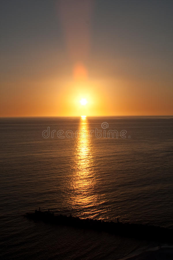 Free Sunset Over Water With Wave Break Stock Photography - 13440892