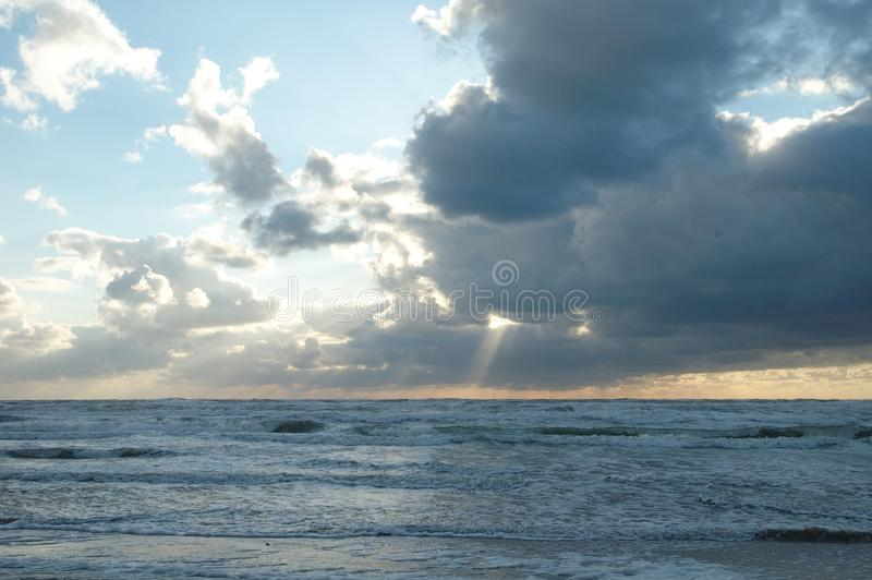 Sunset over waves royalty free stock image