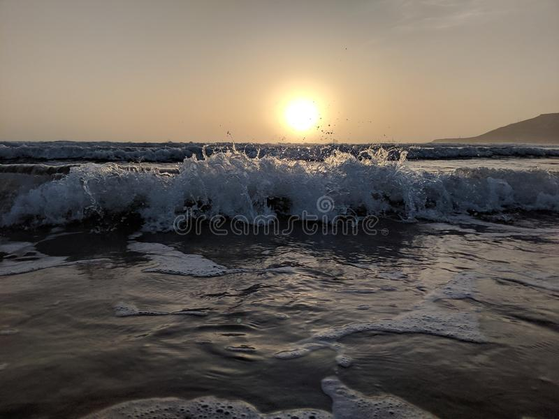 Sunset over the waves royalty free stock photography
