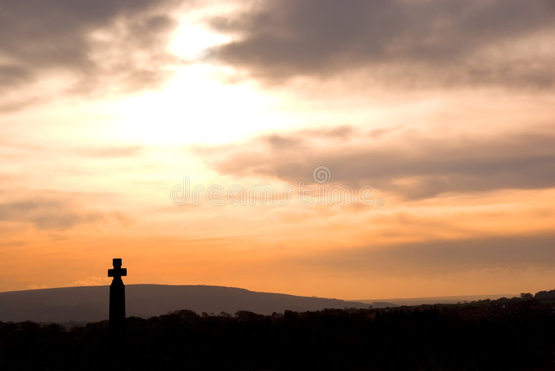 Sunset over Whitby cross royalty free stock photo