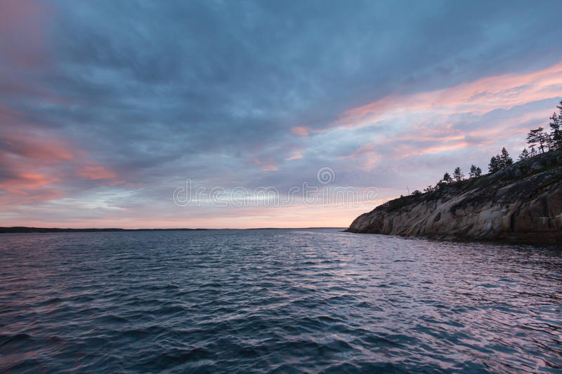 Sunset over White sea in Russia royalty free stock photography