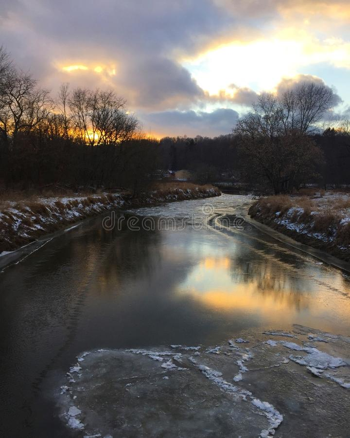 Sunset Over Winter River stock photos
