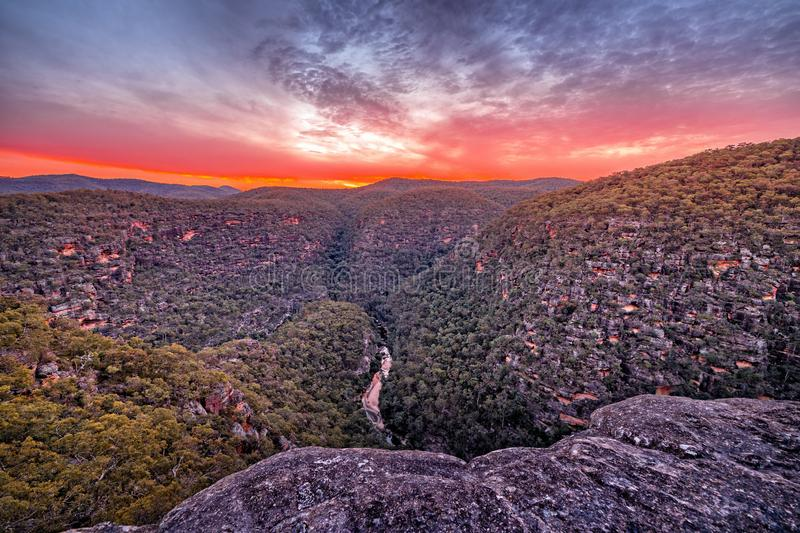Sunset over Wollemi Natinal Park Wilderness. Sunset overlooking the Wollemi National Park Wilderness below a junction of the Colo River and Wollemi creek.  From royalty free stock photos