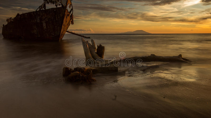 Sunset over the wreck stock images