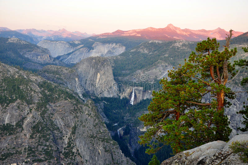Sunset over Yosemite Valley. A photo of the sun setting over yosemite valley royalty free stock images