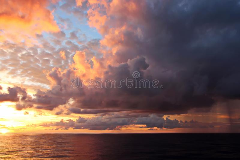 Sunset in the Pacific Ocean. Different types of sunset from the side of the ship while driving and anchoring at the port. Riot of colors of the ocean, clouds stock image