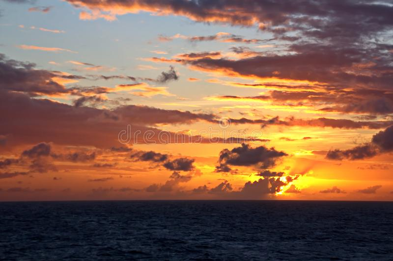 Sunset in the Pacific Ocean. Different types of sunset from the side of the ship while driving and anchoring at the port. Riot of colors of the ocean, clouds stock photo