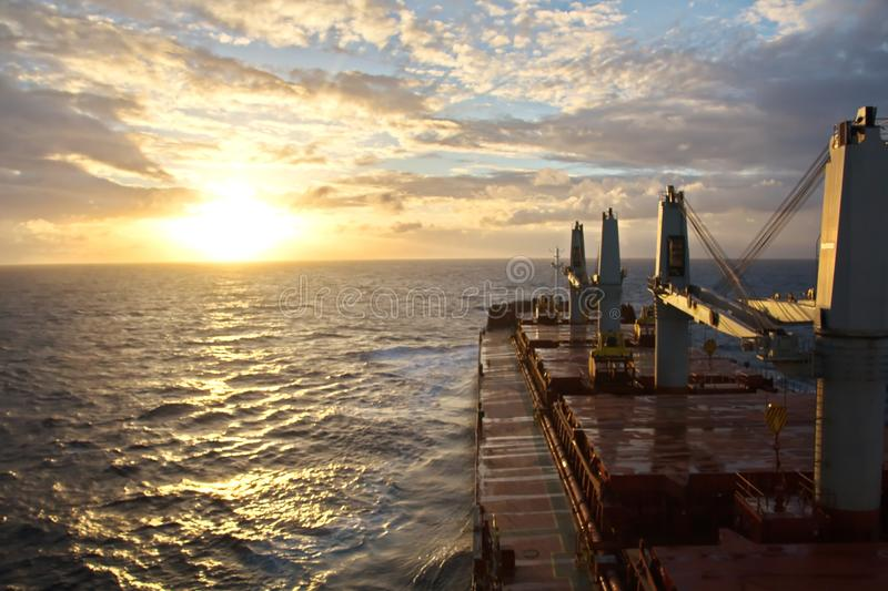 Sunset in the Pacific Ocean. Different types of sunset from the side of the ship while driving and anchoring at the port. Riot of colors of the ocean, clouds stock photography