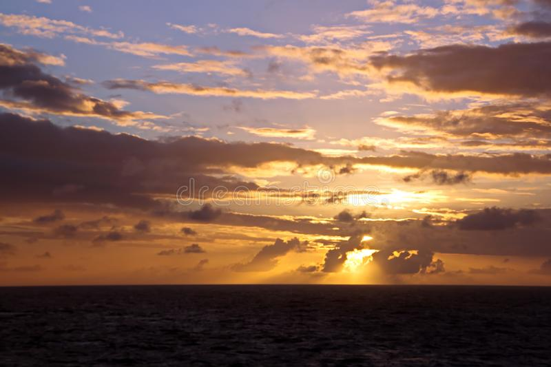 Sunset in the Pacific Ocean. Different types of sunset from the side of the ship while driving and anchoring at the port. Riot of colors of the ocean, clouds royalty free stock image
