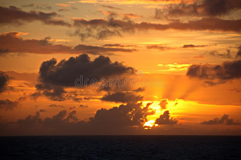 Sunset in the Pacific Ocean. Different types of sunset from the side of the ship while driving and anchoring at the port. Riot of colors of the ocean, clouds stock images