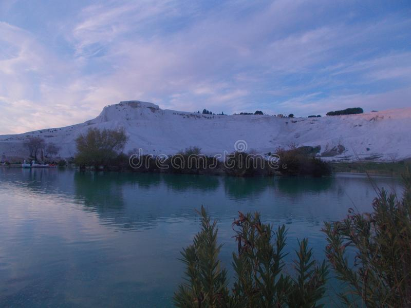 Sunset In Pamukkale With River Landscape. Sunset view captured in Pamukkale, Denizli, with river landscape and sunshine brilliancy royalty free stock photo