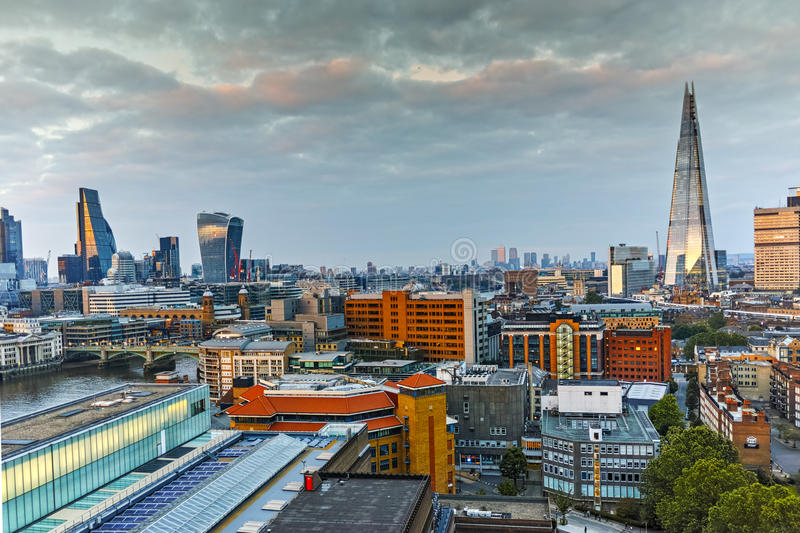 Sunset panorama of city of London and Thames river, England. Great Britain stock photography