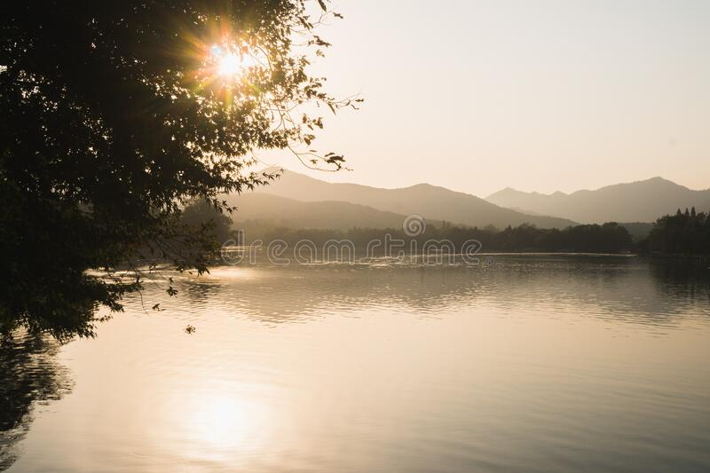 Sunset panoramic view of the West Lake in Hangzhou, China, Asia. Beautiful silhouett. E in sunrise colors royalty free stock photo