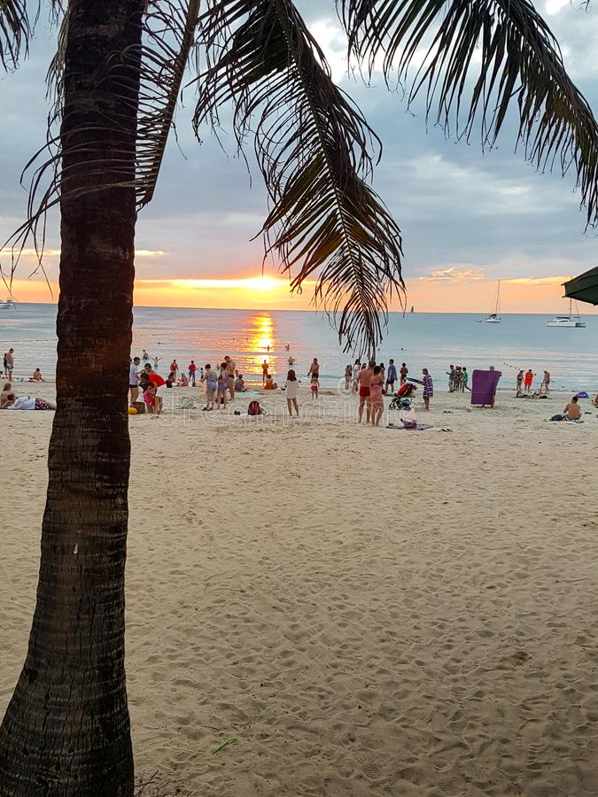 Sunset on a paradisiacal beach. royalty free stock photos