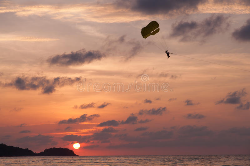 Sunset paragliding stock image