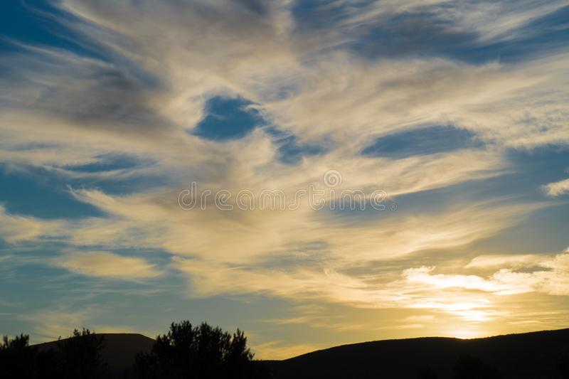 Landscape photo of a Patagonian sunset with some beautiful clouds. Sunset patagonia no people clouds cloudy night argentina city romantic blue sky landscape stock photo